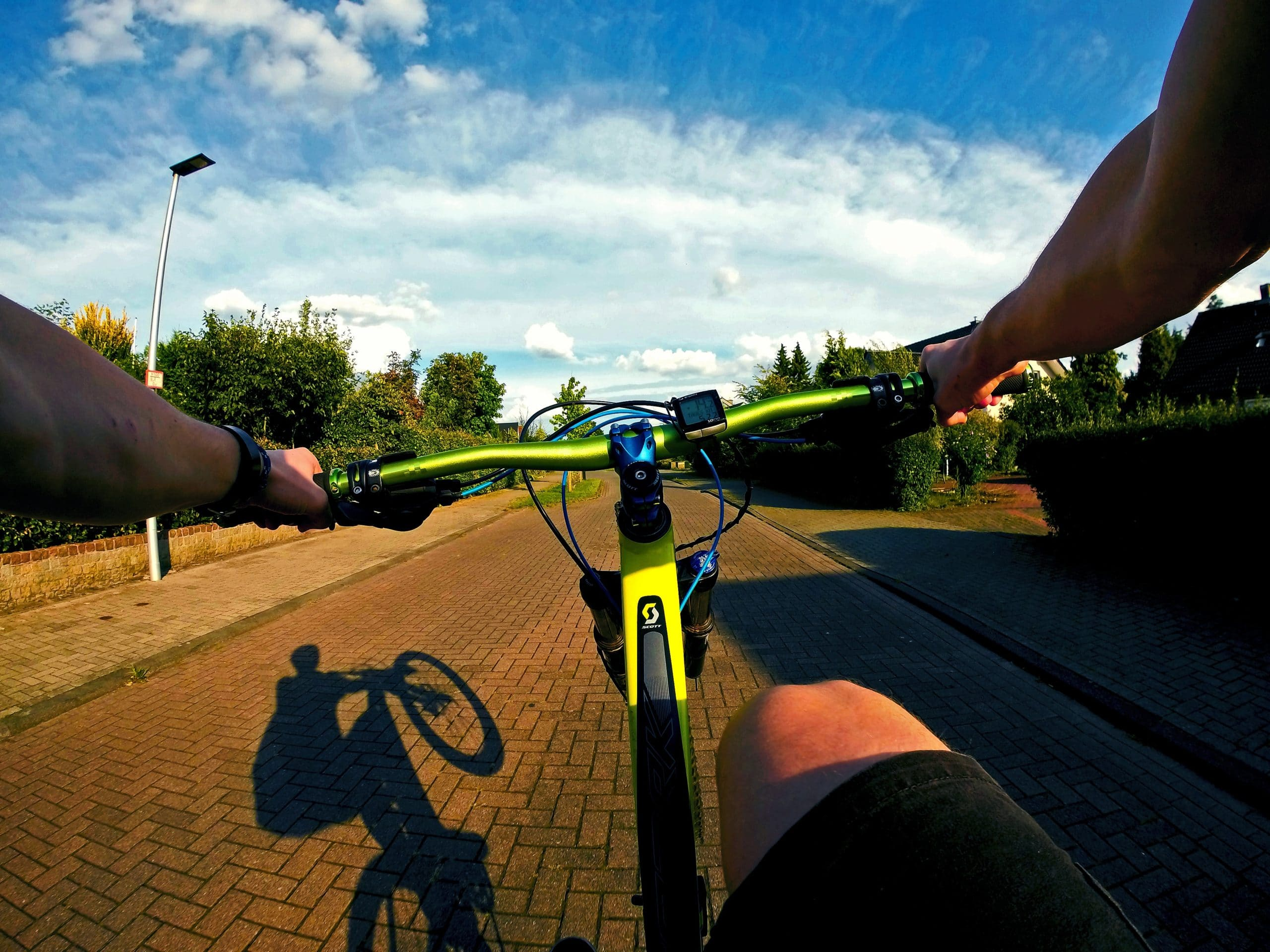 Stiffness of a Carbon Mountain Bike vs. Aluminum: Image of first-person wheelie
